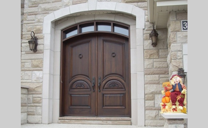 wood arched front door